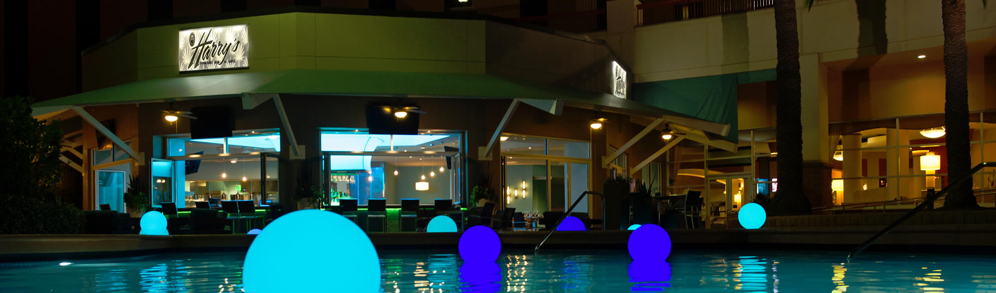 resort pool at night with lighted balls